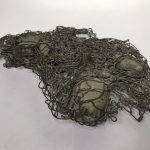 Untitled #1192 stones embedded in mesh (sold)